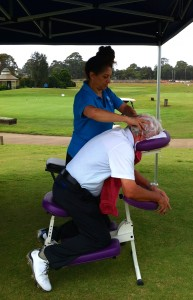 Absolutely Corporate offers seated massage at Lexus of Sutherland team's golf day at Macquarie Links Drive Golf Club. Golfer enjoying a massage.