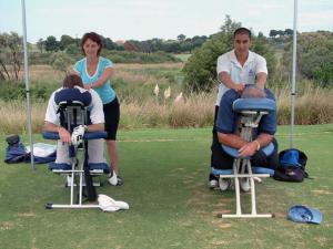 golfers enjoying seated massage